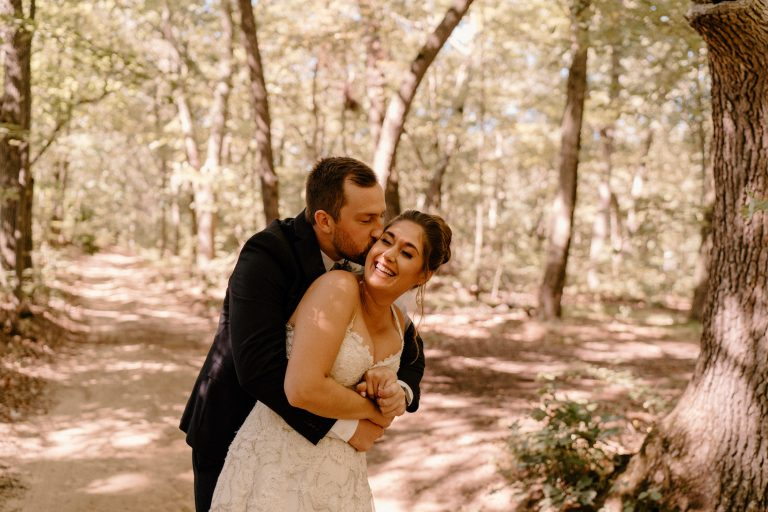 Bride and Groom Hugging and Laughing in the Forest